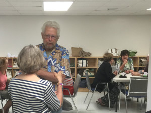 Al Humphrey and Brenda Stone discuss the arrangements for the Friday summer duplicate bridge session.